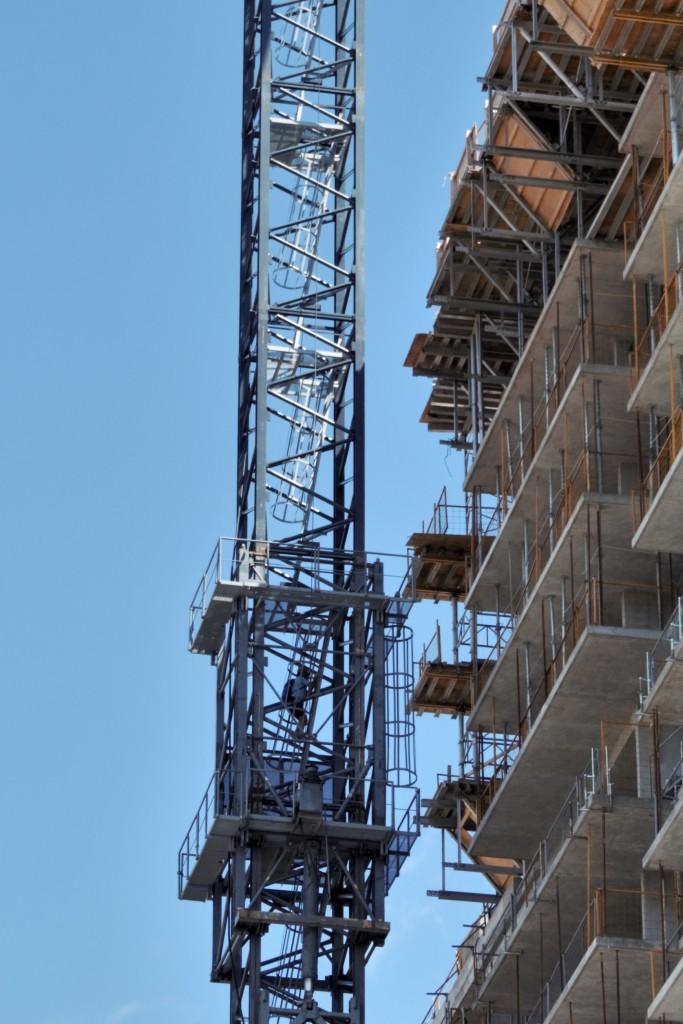 Crane operator climbing tower crane